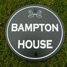 Oval Slate sign with white paint fill