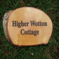 Rustic wood slice house sign with black woodstain finish