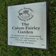 Brushed stainless steel plaque with wooden backing board